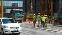 KUALA LUMPUR, MALAYSIA - CIRCA FEB 2015: Construction manager talking with hi Stock Footage