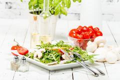 seasonal salad on the white table - stock photo