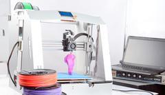 Three-dimensional printer during work - stock photo