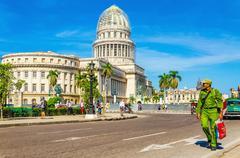 Cuban soldier against the Capitol in Havana, Cuba - stock photo