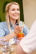 Smiling girl with cocktail in cafe Stock Photos