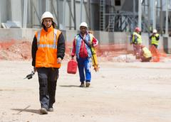Waste plant outside process female worker - stock photo