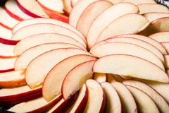 Apple slices arranged in skillet - stock photo