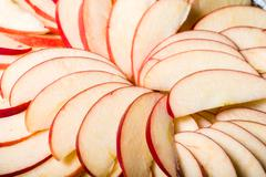 Apple slices arranged in skillet Stock Photos