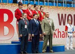 Awardees on podium - stock photo