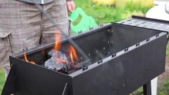 Blowing up coal in barbecue Stock Footage