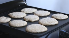 Oat pancakes cooking on electric barbecue Stock Footage