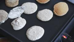 Cooking home made oat pancakes Stock Footage