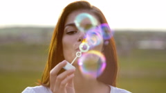 6 in 1 video! The girl and boy (pair) blow air bubbles by sunset background Stock Footage