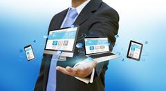 Businessman holding tech device in his hand - stock illustration