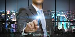 Stock Illustration of Businessman in his office using tactile interface