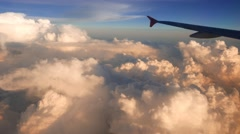 Sundown time and beautiful clouds from the top, airplane view Stock Footage