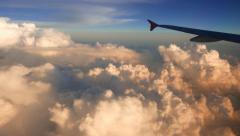 Beautiful cumulus clouds view from aircraft window, timelapse Stock Footage