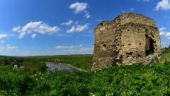 Old fortess ruins tower with moving clouds sky and trembling grass time lapse 4K Stock Footage