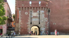 Castle like gate into old city catalonia france zoom out Stock Footage