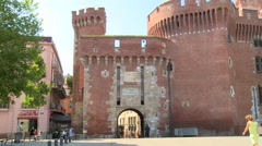 Old red city gate in square Catalonia france Stock Footage