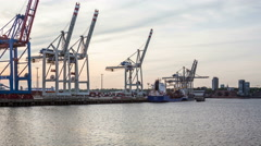 Hamburg harbor with unloading container ship - in the evening hyperlapse Stock Footage