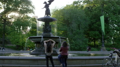 Girls Hanging Out Central Park Bethesda Fountain Statue Slow Motion 4K NYC - stock footage