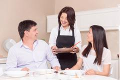 Time for lunch in Asian family - stock photo