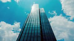 Huge Glass skyscraper sunrays and clouds reflection timelapse 25p Stock Footage