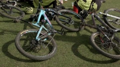 Panning from ground up - Mountain bikers resting, Peebles, Scotland Stock Footage