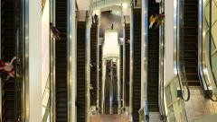 Parallel moving escalators on different levels, straight top view Stock Footage