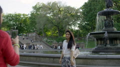 Girl Posing for Picture Central Park Bethesda Fountain Statue Slow Motion 4K NYC - stock footage