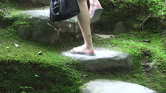 Lady Climbing Stone Stairs In Japanese Garden  Stock Footage