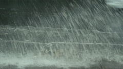 Cars splash the large puddles in gutter after rain Stock Footage