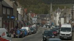 Scottish Borders town of Peebles - panning down scene, top of High St Stock Footage