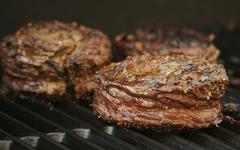 Succulent Wrapped Flank Steak - stock photo