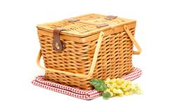 Picnic Basket, Grapes and Folded Blanket Isolated on a White Background. Stock Photos