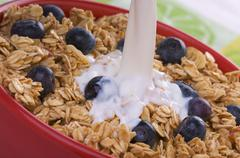 Bowl of Granola and Boysenberries and Milk Stock Photos