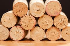 Stack of Wine Corks on a Wood Surface. Stock Photos