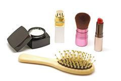 Cosmetic set with parfume blusher brush lipstic and comb on white background Stock Photos