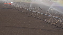 Irrigation water sprinkler agriculture farm field 4K 007 - stock footage