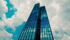 4K 25p office building,skyscraper,sun rays and dramatic clouds reflections,glass - stock footage