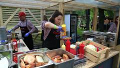 Street vendor prepares the Classical hotdog. - stock footage