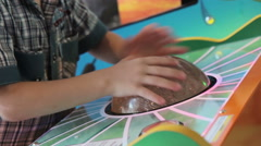 A young boy playing game machine Stock Footage
