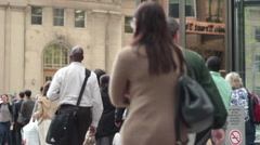 Low Angle Shot Of Pedestrians Beginning Their Commute Home From Work Stock Footage