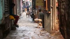 People in narrow street passage in Varanasi. Stock Footage