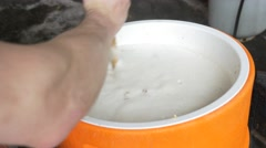 Mashing beer with wooden spoon - home beer brewing Stock Footage