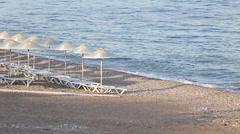 Many straw beach umbrellas at the seashore in Turkey Stock Footage