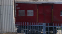 Railway fence with a sign, view during train ride in Agra. Stock Footage
