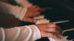 Girl is Studying  a Play on a Piano Stock Footage