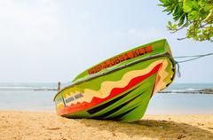 Colourful boat on background of the endless sea - stock photo