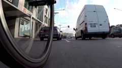 Biking through traffic Super Low Angle Stock Footage