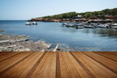 Landscape image of old Mediteranean fishing village with wooden planks floor - stock photo