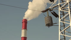 Transmission Tower and smoking Chimneys - stock footage