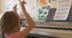 Baby Girl Playing on The Piano Electronic Keyboard with enthusiasm - stock footage